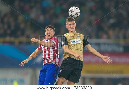 VIENNA, AUSTRIA - OCTOBER 22 Emir Dilaver (#27 Austria) and Christian Rodriguez (#11 Atletico) fight for the ball at a UEFA Champions League game on October 22, 2013 in Vienna, Austria.