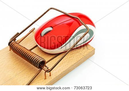 the mouse of a computer in a mousetrap. symbol photo for costs case, debt and roaming charges.