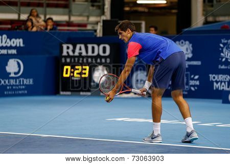 SEPTEMBER 23, 2014 - KUALA LUMPUR, MALAYSIA: Pierre-Hugues Herbert of France prepares to make a serve in his first round match at the Malaysian Open Tennis 2014. This is an ATP sanctioned tournament.