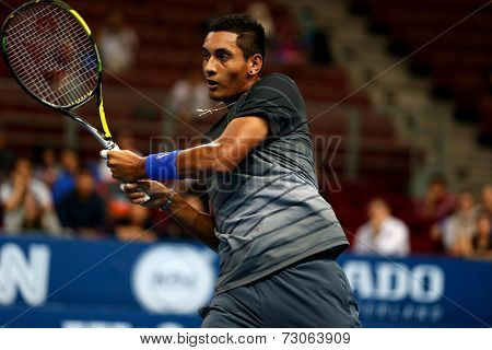 SEPTEMBER 23, 2014 - KUALA LUMPUR, MALAYSIA: Nick Kyrgios of Australia reacts after making a return in his first round match at the Malaysian Open Tennis 2014. This is an ATP sanctioned tournament.