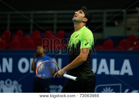 SEPTEMBER 23, 2014 - KUALA LUMPUR, MALAYSIA: Marinko Matosevic of Australia watches the call review on the screen in his match at the Malaysian Open Tennis 2014. This is an ATP sanctioned tournament.