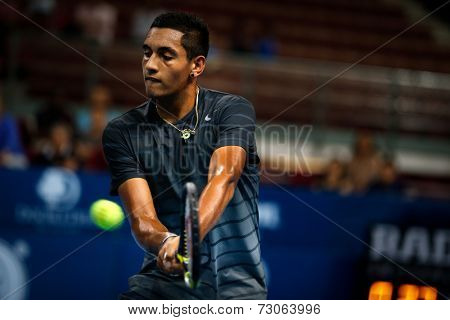 SEPTEMBER 23, 2014 - KUALA LUMPUR, MALAYSIA: Nick Kyrgios of Australia makes a backhand return in his first round match at the Malaysian Open Tennis 2014. This is an ATP sanctioned tournament.