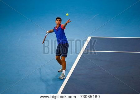 SEPTEMBER 25, 2014 - KUALA LUMPUR, MALAYSIA: Pierre-Hugues Herbert of France tosses the ball to serve in his match at the Malaysian Open Tennis 2014. This is an ATP sanctioned tournament.