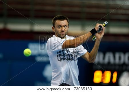 SEPTEMBER 25, 2014 - KUALA LUMPUR, MALAYSIA: Michal Przysiezny of Poland makes a backhand return in his match at the Malaysian Open Tennis 2014. This is an ATP sanctioned tournament.