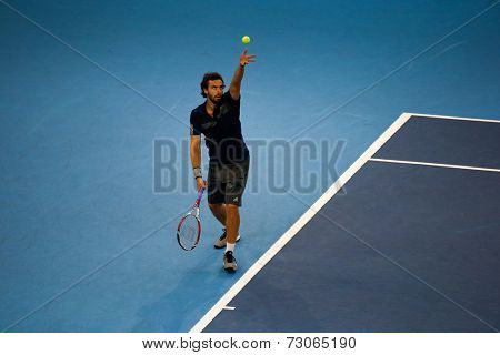 SEPTEMBER 25, 2014 - KUALA LUMPUR, MALAYSIA: Ernests Gulbis of Latvia tosses the ball to serve in his match at the Malaysian Open Tennis 2014. This is an ATP sanctioned tournament.