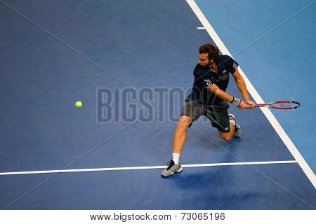 SEPTEMBER 25, 2014 - KUALA LUMPUR, MALAYSIA: Ernests Gulbis of Latvia attempts a backhand return in his match at the Malaysian Open Tennis 2014. This is an ATP sanctioned tournament.
