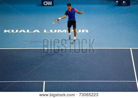 SEPTEMBER 25, 2014 - KUALA LUMPUR, MALAYSIA: Pierre-Hugues Herbert of France attempts a forehand return in his match at the Malaysian Open Tennis 2014. This is an ATP sanctioned tournament.