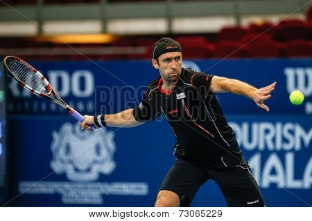 SEPTEMBER 25, 2014 - KUALA LUMPUR, MALAYSIA: Benjamin Becker of Germany makes a forehand return in his match at the Malaysian Open Tennis 2014. This is an ATP sanctioned tournament.