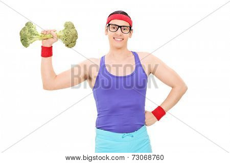 Nerdy man lifting a broccoli dumbbell isolated on white background