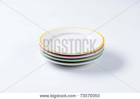 side view of four stacked ceramic plates