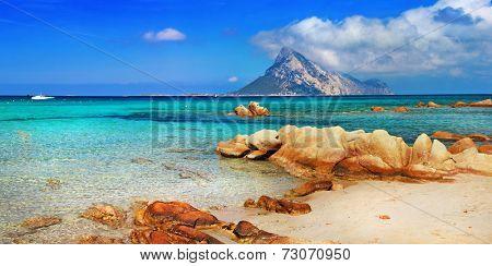 Sardinia holidays, azure sea , island Tavolara, Italy