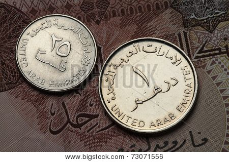 Coins of the United Arab Emirates. UAE one dirham and twenty five fils coins.