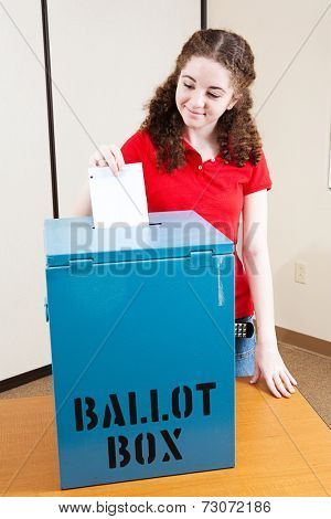 Eighteen year old Latina girl voting for the first time.