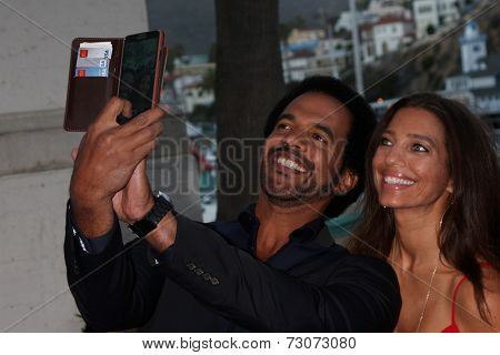 AVALON - SEP 27:  Kristoff St. John, Dana Derrick at the Catalina Film Festival Gala at the Casino on September 27, 2014 in Avalon, Catalina Island, CA