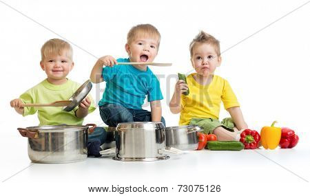 Kids group cooking isolated on white. Three boys are playing with pans and food.