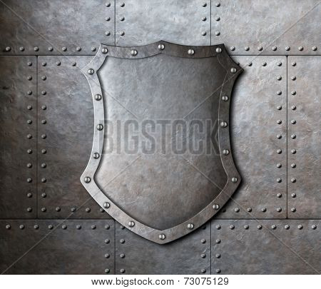 metal shield over armor plates background