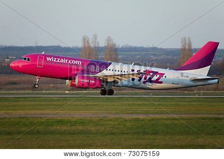 BUDAPEST, HUNGARY - MAY 5: Wizzair A320 landing at Budapest Liszt Ferenc Airport, May 5th 2014. Budapest is one of Wizzair's most important bases.