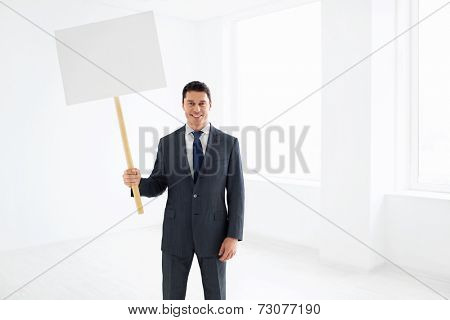 Businessman in a suit with a message
