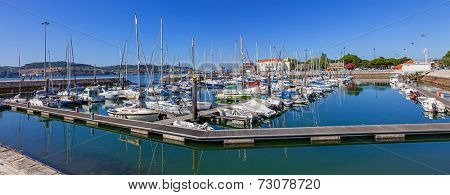Lisbon, Portugal. August 24, 2014: Doca do Bom Sucesso Marina in the Belem district of Lisbon filled with docked yachts, sailboats and motorboats on a sunny summer day.
