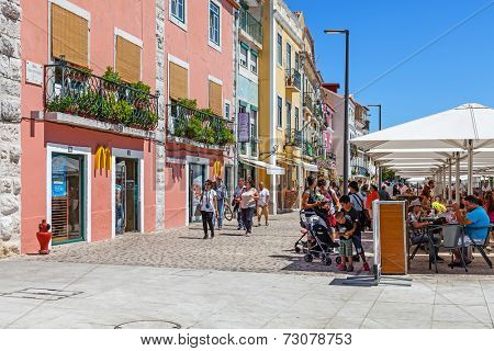 Lisbon, Portugal. August 24, 2014: The Belem McDonalds fast-food restaurant and esplanade during lunch time in Lisbon. This McDonalds restaurant is located in a World Heritage area full of tourists