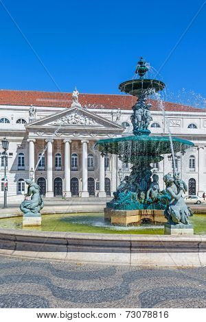 Lisbon, Portugal. August 31, 2014: Close-up on one of the two fountains of the Dom Pedro IV Square, better known as Rossio. Dona Maria II National Theatre in background