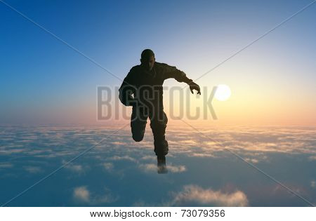 Man running on clouds
