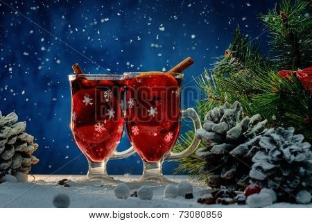 Cups with hot mulled wine in Christmas still life