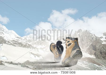 Pair of hikers boots walking on path