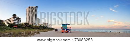 Miami Beach sunset panorama with lifeguard tower and hotels.