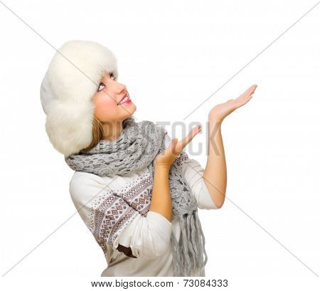 Young woman shows pointing gesture isolated