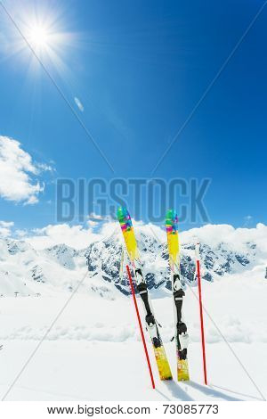 Skiing, winter sport , mountains and ski equipments on ski run