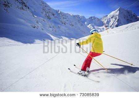 Ski, skier on ski run - woman skiing downhill, winter sport