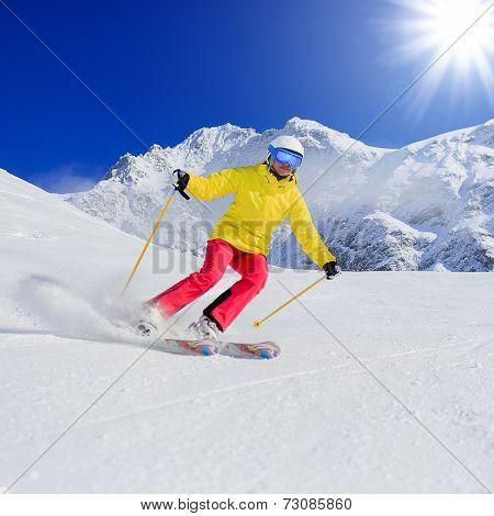 Skiing, skier, winter sport - woman skiing downhill