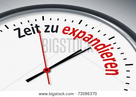 An image of a typical clock with text time to expand in german language