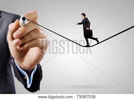 Businessman walking on drawn line. Risk concept