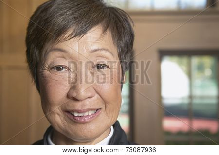 Close up of senior Asian woman smiling