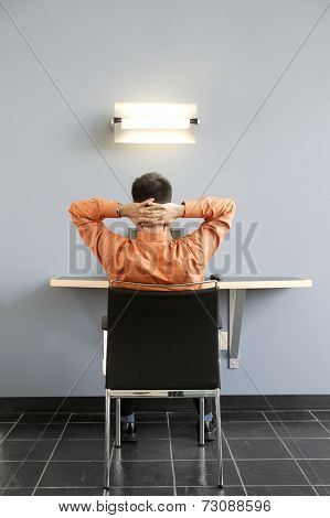 Rear view of businessman at desk