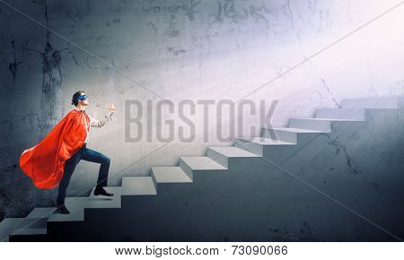 Young man walking up the stair case