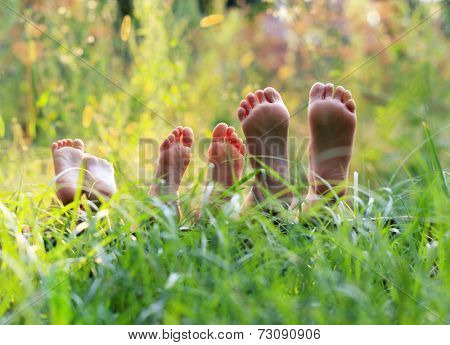 Happy children lying on green grass