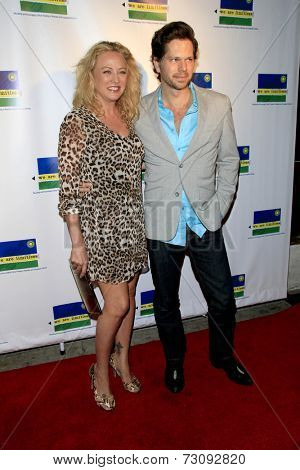LOS ANGELES - SEP 23:  Virginia Madsen, Nick Holmes at the We Are Limitless' 2nd Annual Celebrity Poker Tournament at Hyperion Public on September 23, 2014 in Los Angeles, CA