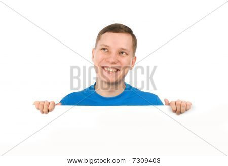 Young Man Looking Over A Blank Board
