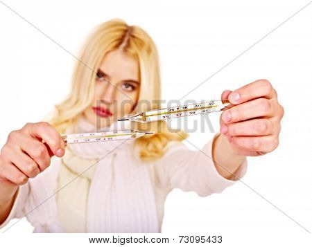 Young woman  taking thermometer. Sharpness on thermometer.
