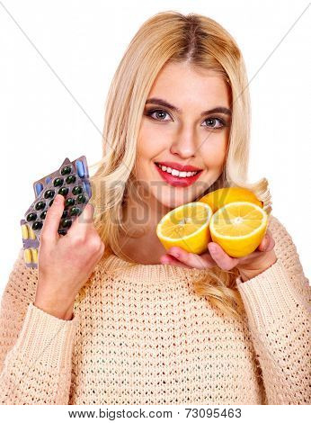 Woman having remedy and lemon. Isolated.