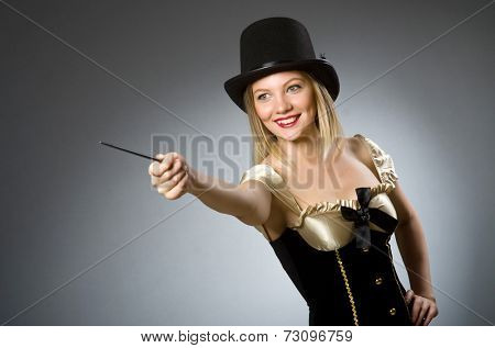 Woman magician with magic wand and hat