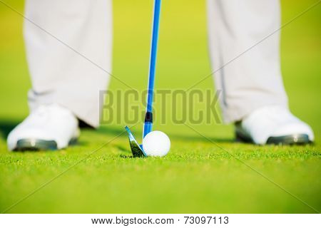 Golf Ball on Fairway Grass, Man about to Hit Ball with Iron