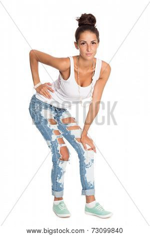 Stylish young woman in torn jeans.