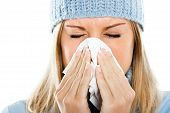 stock photo of blowing nose  - Young woman having flu and blowing her nose - JPG