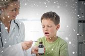 foto of cough syrup  - Doctor giving little boy cough syrup against snow falling - JPG
