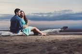 picture of couple sitting beach  - Summer - JPG