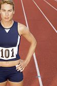 picture of bare midriff  - Female athlete on running track half length - JPG